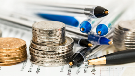Coins and pens on a report
